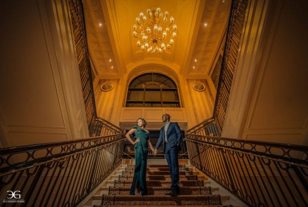 Couple photoshoot in beautiful stairs holding hands