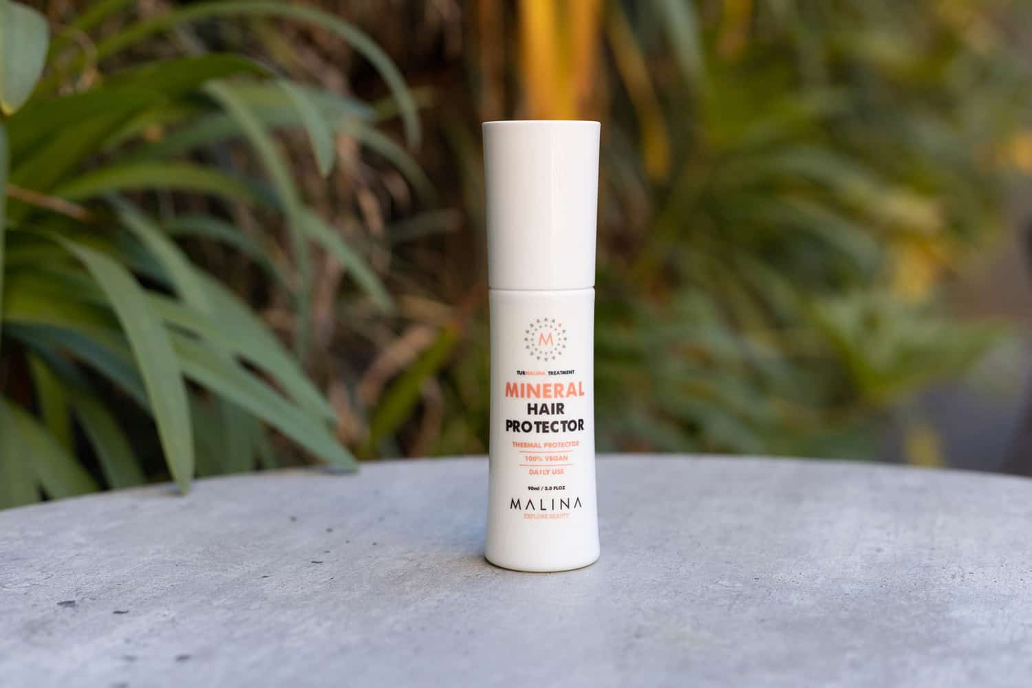 malina heat protectant spray used for curling hair with a straightener