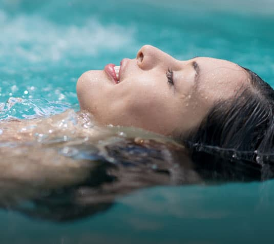 woman floating in mineral water