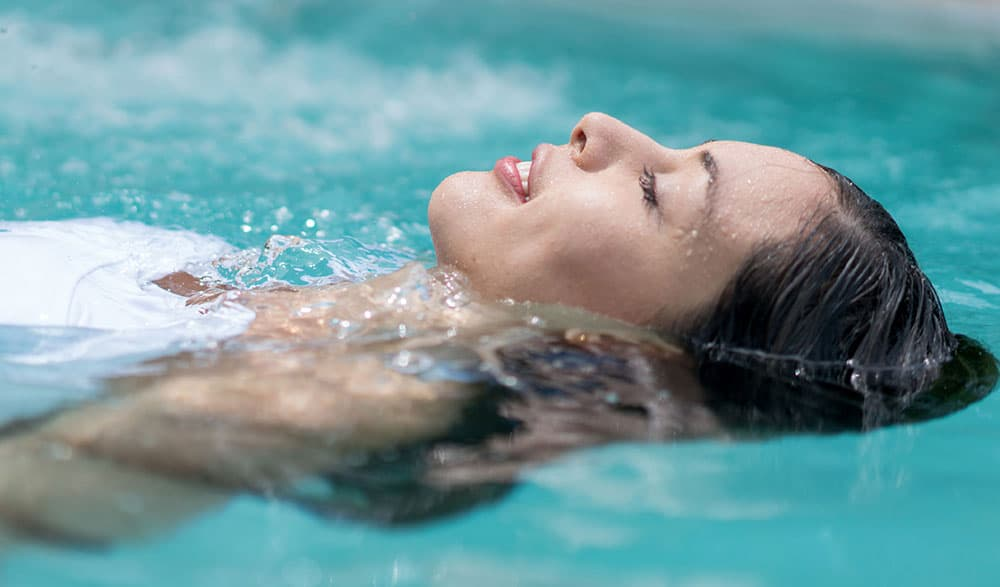 woman floating in mineral spring water